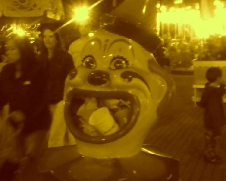 Scary Clown with a mouth full of garbage. taken by my cheapo Verizon camera phone at The Big E.