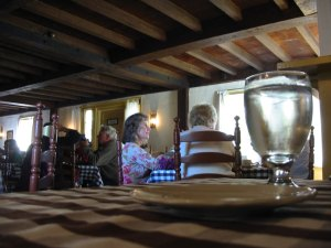 The tavern has brown checked tablecloths.