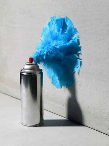 Spray can emitting feathers